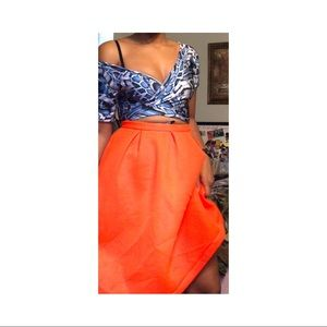 Bright orange skirt